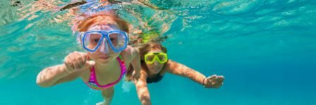 kids swimming underwater with scuba masks
