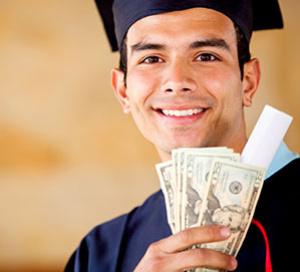 boy graduate holding money from gh miller scholarship