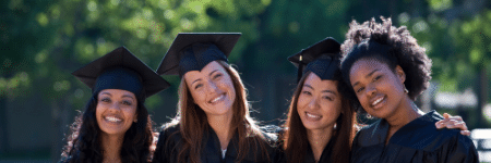 group of smiling women college graduates