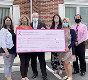 1ST SUMMIT BANK presents check to non profit