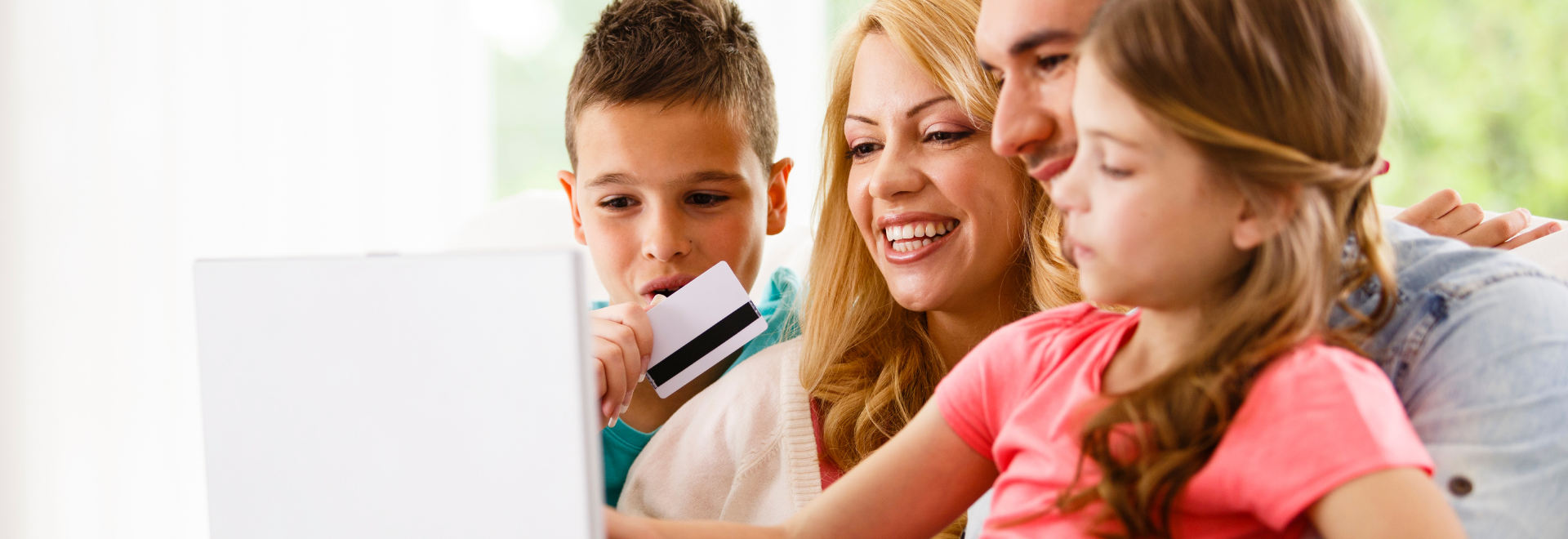 family shopping online with a prepaid card or debit card or credit card