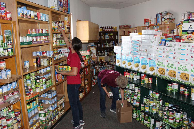 1ST SUMMIT BANK employees stock food pantry shelves